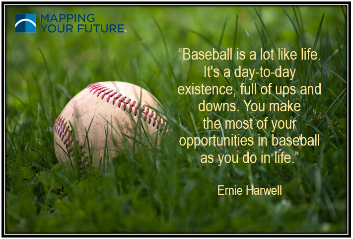 Baseball laying in the grass with a success quote
