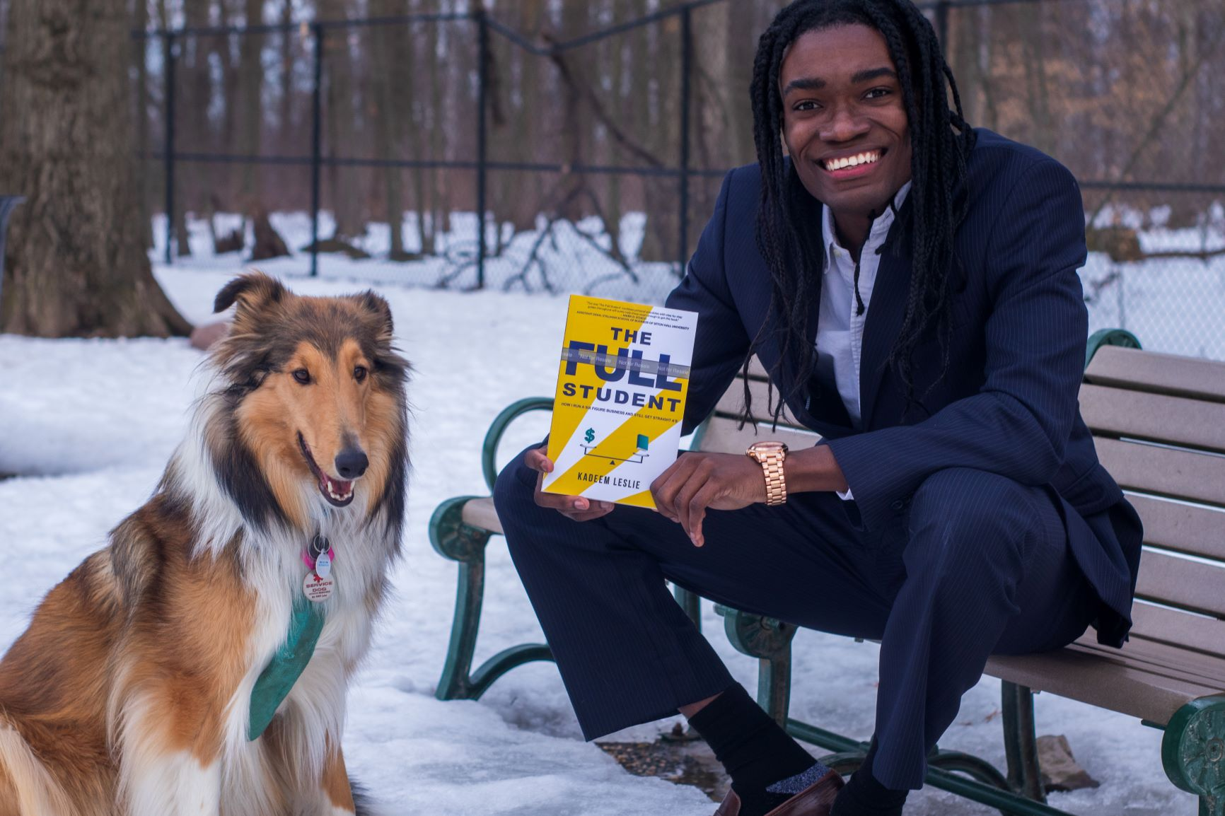 Kadeem Leslie with his dog and The Full Student book